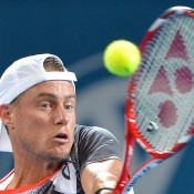 Lleyton Hewitt of Australia plays a bakhand in his match against Sam Groth of Australia during day three of the 2015 Brisbane International at Pat Rafter Arena on January 6, 2015 in Brisbane, Australia.  (Photo by Bradley Kanaris/Getty Images)