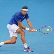 Marinko Matosevic of Australia plays a backhand in his match against Steve Johnson of the USA during day three of the 2015 Brisbane International at Pat Rafter Arena on January 6, 2015 in Brisbane, Australia.  (Photo by Chris Hyde/Getty Images)