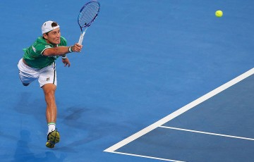 Matt Ebden of Australia plays a forehand in his match against Jerzy Janowicz of Poland during day one of the 2015 Hopman Cup at Perth Arena on January 4, 2015 in Perth, Australia.  (Photo by Paul Kane/Getty Images)