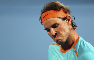 Rafael Nadal of Spain reacts  during the play-off match for third place of the Mubadala World Tennis Championship at Zayed Sport City on January 3, 2015 in Abu Dhabi, United Arab Emirates.  (Photo by Francois Nel/Getty Images)