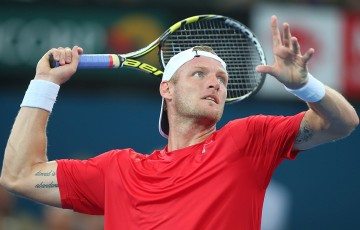 Sam Groth of Australia plays an overhead shot in his match against Lukasz Kubot of Poland during day five of the 2015 Brisbane International at Pat Rafter Arena on January 8, 2015 in Brisbane, Australia.  (Photo by Chris Hyde/Getty Images)