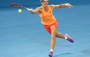 Samantha Stosur of Australia plays a forehand in her match against Varvara Lepchenko of the USA during day one of the 2015 Brisbane International at Pat Rafter Arena on January 4, 2015 in Brisbane, Australia.  (Photo by Chris Hyde/Getty Images)