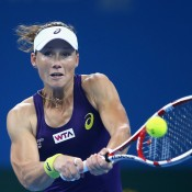 BEIJING, CHINA - OCTOBER 04:  Samantha Stosur of Australia returns a shot during her semifinal match against Petra Kvitova of Czech Republic during day eight of the China Open at the China National Tennis Center on October 4, 2014 in Beijing, China.  (Photo by Feng Li/Getty Images)