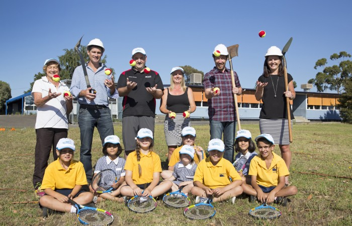 Australian Open 2015. Tennis Cares. Resevoir East Primary School Robin O'Neill (Manager of Govt. Relations and Strategic Projects Tennis Australia) and James Cumming (Principal Resevoir East Primary School) turn the first sod for the Hot Shot Courts