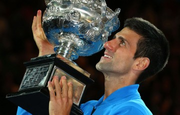 Novak Djokovic holds aloft the Australian Open 2015 winner's trophy; Getty Images
