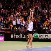 Andrea Petkovic celebrates her victory over Jarmila Gajdosova in the second reverse singles rubber, sealing an unassailable 3-1 lead for Germany in their Fed Cup World Group first round tie against Australia in Stuttgart; Getty Images