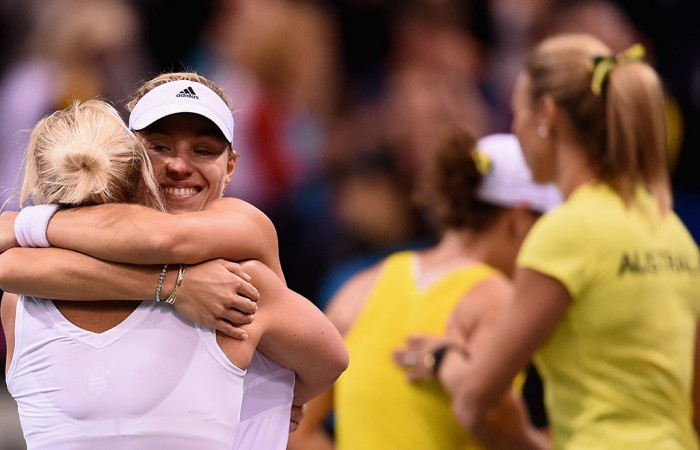 Angelique Kerber celebrates her victory over Sam Stosur in the reverse singles of the Australia v Germany Fed Cup tie in Stuttgart with German captain Barbara Rittner; Getty Images