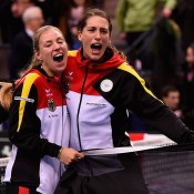 Angelique Kerber (L) and Andrea Petkovic celebrate Germany's Fed Cup victory over Australia in Stuttgart; Getty Images