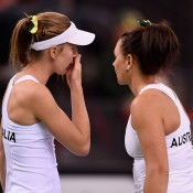 Olivia Rogowska (L) and Casey Dellacqua in action during the doubles rubber of the Australia v Germany Fed Cup tie in Stuttgart; Getty Images