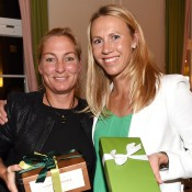 German and Australian Fed Cup team captains Barbara Rittner (L) and Alicia Molik exchange gifts at the official team dinner; Paul Zimmer/ITF