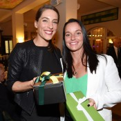 Andrea Petkovic (L) and Jarmila Gajdosova exchange gifts at the Fed Cup official team dinner; Paul Zimmer/ITF