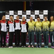 The German and Australian Fed Cup teams pose together at the official draw ceremony ahead of their World Group first round tie in Stuttgart, Germany; Paul Zimmer/ITF