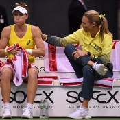 Sam Stosur (L) consults with captain Alicia Molik during her singles rubber loss to Andrea Petkovic during the Australia v Germany World Group 2015 first round tie in Stuttgart, Germany; Getty Images