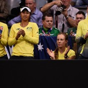 (L-R) Casey Dellacqua, Priscilla Hon, Olivia Rogowska and Sam Stosur cheer on Aussie teammate Jarmila Gajdosova during her victory over Angelique Kerber in the first singles rubber of the Australia v Germany Fed Cup tie; Getty Images