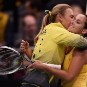 Australian Fed Cup captain Alicia Molik (L) embraces Jarmila Gajdosova following Gajdosova's victory over Angelique Kerber; Getty Images