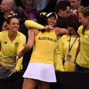 Jarmila Gajdosova is embraced by Priscilla Hon after defeating Angelique Kerber in the opening singles rubber of the Australia v Germany Fed Cup tie, as teammates Casey Dellacqua (L) and Olivia Rogowska (R) watch on; Getty Images