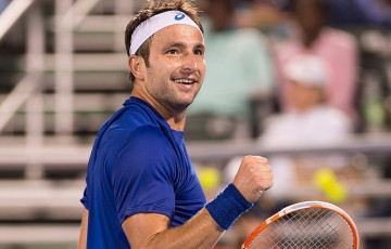 Marinko Matosevic in action during his defeat of No.2 seed John Isner at the ATP Delray Beach Open; CameraSport