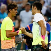 Bernard Tomic (R) shakes hands with Thanasi Kokkinakis after winning their fourth-round match at the 2015 BNP Paribas Open in Indian Wells, California; Getty Images