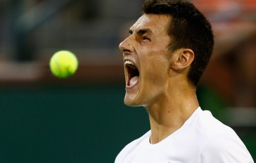 Bernard Tomic celebrates his fourth-round defeat of compatriot Thanasi Kokkinakis at the 2015 BNP Paribas Open in Indian Wells, California; Getty Images