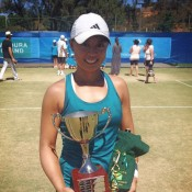 Alison Bai holds the trophy after winning the women's singles title at the Mildura Grand International