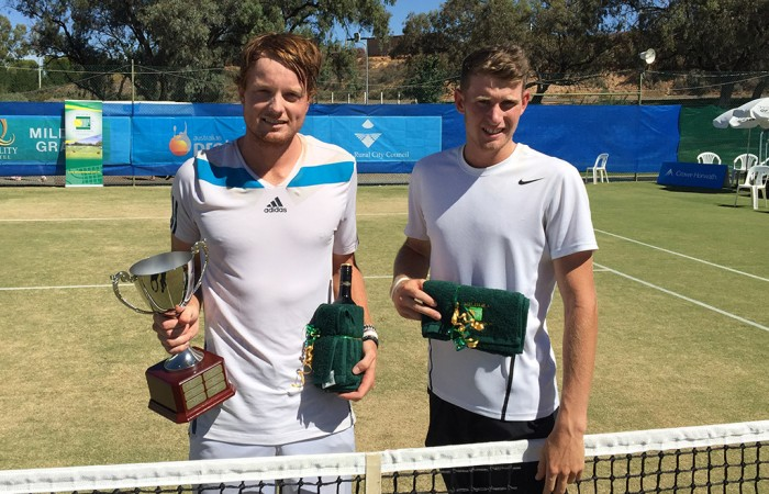 Matthew Barton (L) poses with his trophy after defeating Harry Bourchier (R) in the men's singles final of the Mildura Grand International