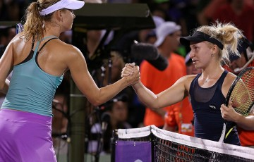 Daria Gavrilova (L) shakes hands with Maria Sharapova following her second round victory over the No.2 seed at the Miami Open; Getty Images
