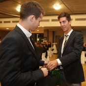 Adam Pavlasek (L) and Thanasi Kokkinakis exchange gifts at the official team dinner for the Davis Cup World Group tie between Australia and Czech Republic; Pavel Lebeda
