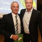 Australian Davis Cup captain Wally Masur (L) and Czech captain Jaroslav Navratil exchange gifts at the official team dinner for the Davis Cup World Group tie between Australia and Czech Republic; Pavel Lebeda