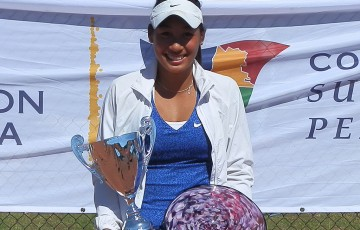 Priscilla Hon poses with her trophy after winning the Mornington Peninsula Women's Tennis International Pro Tour title