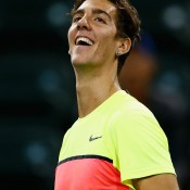 Thanasi Kokkinakis celebrates his first-round win over Germany's Jan-Lennard Struff at the BNP Paribas Open at Indian Wells; Getty Images