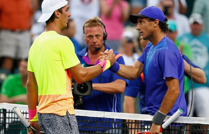 Thanasi Kokkinakis (L) shakes hans with Juan Monaco after winning their third-round match at the BNP Paribas Open at Indian Wells; Getty Images