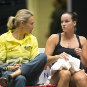 Australian captain Alicia Molik (L) and Jarmila Gajdosova talk tactics during the second of the reverse singles rubbers in the Netherlands v Australia Fed Cup World Group Play-off tie in 's-Hertogenbosch; Getty Images
