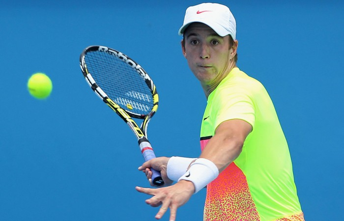 Andrew Harris of Australia plays a forehand in his qualifying match against Andreas Beck of Germany for 2015 Australian Open at Melbourne Park on January 16, 2015 in Melbourne, Australia. (Photo by Robert Prezioso/Getty Images)