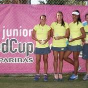 Australia's victorious Junior Fed Cup team of (L-R) Seone Mendez, Jaimee Fourlis, Destanee Aiava and captain Rohan Fisher at the Shepparton Lawn Tennis Club; Trevor Phillips