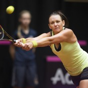 Casey Dellacqua in action during her victory over Arantxa Rus in the second singles rubber of the Australia v Netherlands Fed Cup World Group Play-off tie in 's-Hertogenbosch; Getty Images