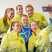Australia's Fed Cup team take a selfie with a young fan at the official draw ceremony ahead of their 2015 World Group Play-off tie against the Netherlands in 's-Hertogenbosch; Henk Koster