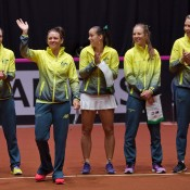 Australia's Fed Cup team of (L-R) Sam Stosur, Casey Dellacqua, Jarmila Gajdosova, Olivia Rogowska and captain Alicia Molik on court for the opening ceremony of the Netherlands v Australia Fed Cup World Group Play-off tie in 's-Hertogenbosch; Henk Koster