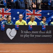 The Australian Fed Cup team of (L-R) team manager Fi Luscombe, orange girl Kimberly Birrell, Sam Stosur and Olivia Rogowska watch from the sidelines during the Netherlands v Australia Fed Cup World Group Play-off tie in 's-Hertogenbosch; Henk Koster