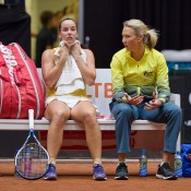 Australian captain Alicia Molik (R) chats to Jarmila Gajdosova during the opening singles rubber of the Netherlands v Australia Fed Cup World Group Play-off tie in 's-Hertogenbosch; Henk Koster