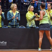 Casey Dellacqua shakes hands with Australian coach Nicole Pratt after winning the second singles rubber of the Netherlands v Australia Fed Cup World Group Play-off tie in 's-Hertogenbosch; Henk Koster