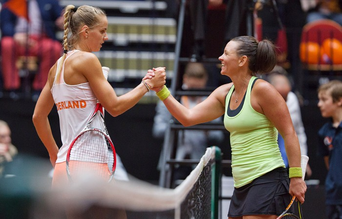 Casey Dellacqua (R) shakes hands with Arantxa Rus after winning their second singles rubber in the Netherlands v Australia Fed Cup World Group Play-off tie in 's-Hertogenbosch; Henk Koster