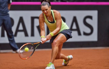 Casey Dellacqua in action during the second singles rubber of the Netherlands v Australia Fed Cup World Group Play-off tie in 's-Hertogenbosch; Henk Koster