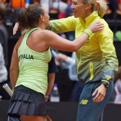Casey Dellacqua (L) hugs team captain Alicia Molik after winning the second singles rubber of the Netherlands v Australia Fed Cup World Group Play-off tie in 's-Hertogenbosch; Henk Koster