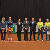 The Dutch and Australian teams on court ahead of the Netherlands v Australia Fed Cup World Group Play-off tie in 's-Hertogenbosch; Henk Koster