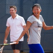 Jeanette Lin (R) and Todd Woodbridge; Elizabeth Xue Bai