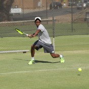 Benard Nkomba takes part in a practice session ahead of the Junior Davis Cup and Junior Fed Cup Asia/Oceania qualifying competition at Shepparton Lawn Tennis Club; Trevor Phillips