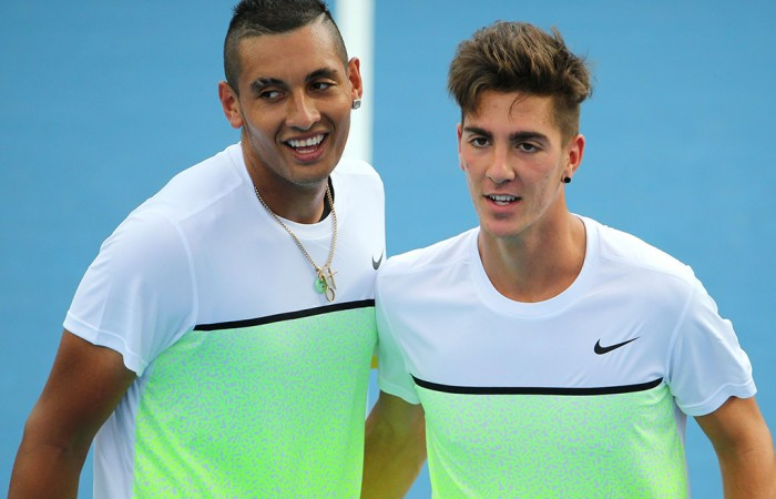 Nick Kyrgios (L) and Thanaski Kokkinakis in action at Australian Open 2015; Getty Images