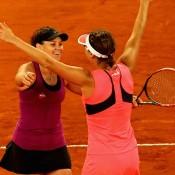 Casey Dellacqua (L) and Yaroslava Shvedova celebrate their doubles title at the 2015 Mutua Madrid Open; Getty Images