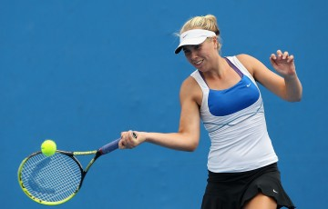 MELBOURNE, AUSTRALIA - DECEMBER 16:  Abbie Myers of Australia plays a forehand in her first round match against Zoe Hives of Australia during the 2015 Australian Open play off at Melbourne Park on December 16, 2014 in Melbourne, Australia.  (Photo by Robert Prezioso/Getty Images)