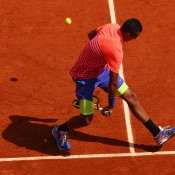 Nick Kyrgios plays a winning tweener lob during his third round loss to No.3 seed Andy Murray on Court Suzanne Lenglen; Getty Images